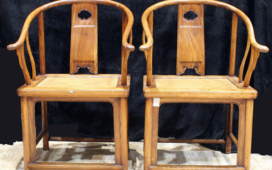 A Chinese pair elmwood horseshoe chairs