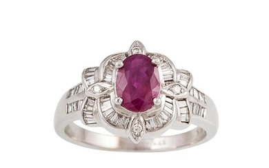 A DIAMOND AND RUBY CLUSTER RING, the oval ruby to a baguette...