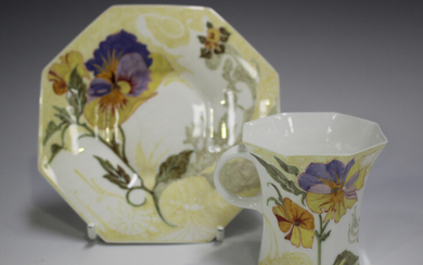 A Rozenburg den Haag eggshell porcelain coffee cup and saucer, circa 1908, painted with flowers, pri
