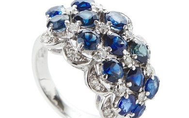 A SAPPHIRE AND DIAMOND DRESS RING IN 18CT WHITE OLD, COMPRISING THIRTEEN BLUE SAPPHIRES TOTALLING 6.30CTS, SPACED WITH ROUND BRILLI...