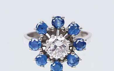 A Solitaire Diamond Ring with Sapphires.