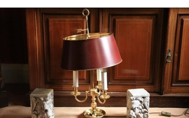 A brass three branch Desk Lamp, with metal shade on circular...
