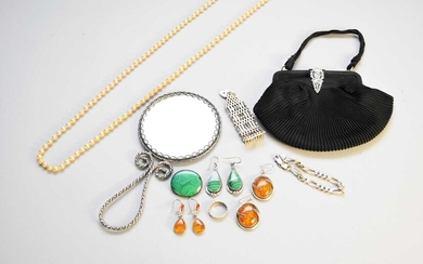 A collection of various pieces of costume jewellery
