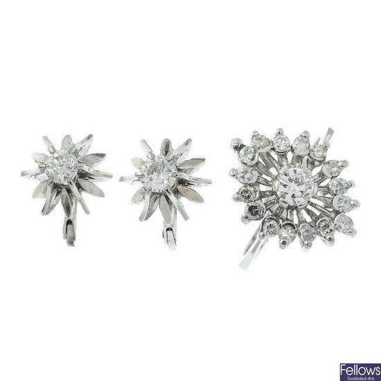 A diamond dress ring and a pair of diamond earrings.