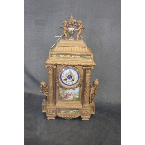 A late 19th century gilt painted spelter mantel clock, with ...