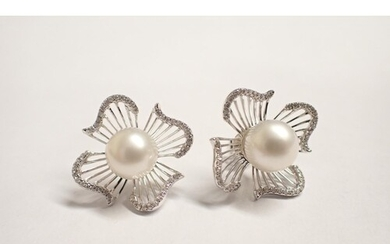 A pair of Cultured Pearl and Diamond flowerhead Earrings eac...