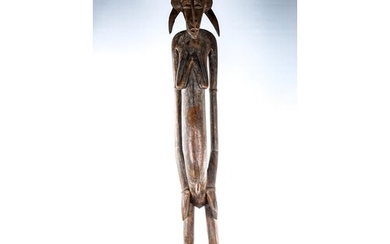 An African carved wood standing Tribal fertility figure, hei...