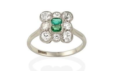 An Emerald and Diamond Cluster Ring, two emerald-cut emeralds within...