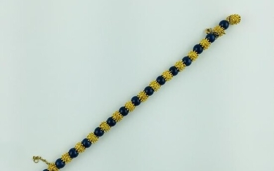 Bracelet in 18 K yellow gold and lapis lazuli sphere