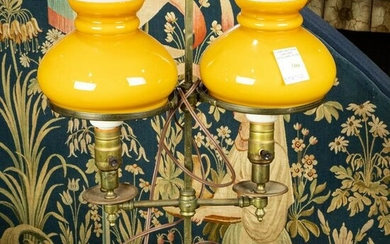 Brass double student lamp, with orange color glass