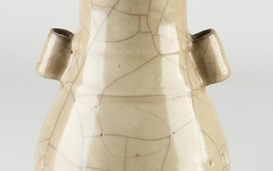 Chinese celadon vase with ears, H 18.6 cm.