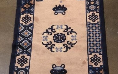Chinese rug with a center floral medallion and a cobalt