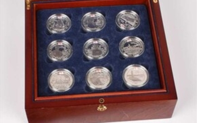 """Collection of Royal Mint """"The History of the Royal Navy Collection"""" proof silver £5 coins."""
