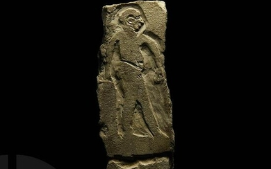 Egyptian Limestone Relief with Striding Figure