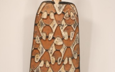 PNG, Asmat, war shield, rectangular shaped with anthropomorphic figure on top, the fngers on the...