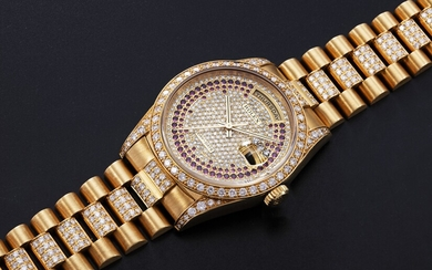 ROLEX, A GOLD OYSTER PERPETUAL DAY-DATE WITH DIAMONDS AND RUBIES, REF. 18388