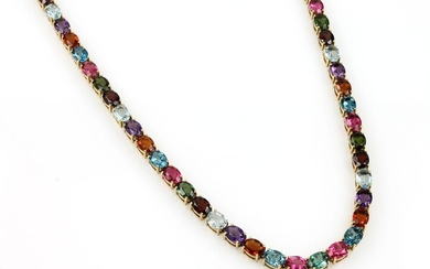 18 kt gold necklace with coloured stones...