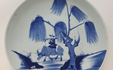 A Chinese shallow dish, decorated a man playing a flute ridi...