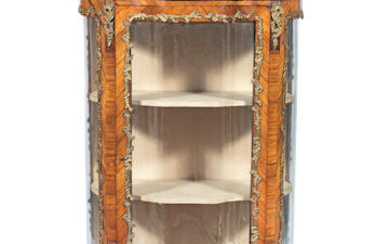 A French late 19th/early 20th century gilt brass mounted rosewood serpentine vitrine