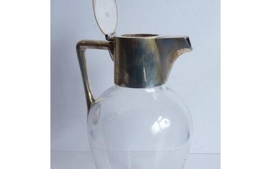 A late 19th century ovoid claret jug; silver mounts and star...