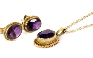 A pair of 9ct gold single stone amethyst earrings