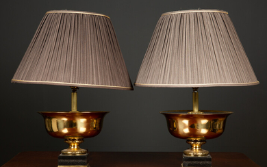 A pair of gilt metal and ebonised table lamps