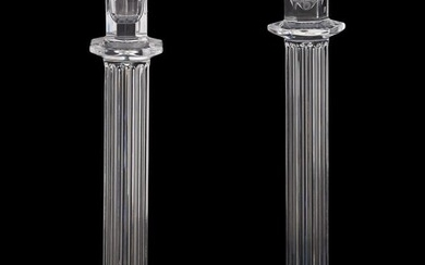 A pair of press moulded clear glass columnar candlesticks by William Yeoward