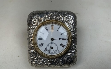 A sterling silver travel clock with repousse decoration in o...