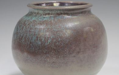 A studio pottery vase, early 21st century, of bulbous form, covered in a streaky purple and pale blu