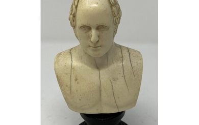 An early 19th century English carved ivory bust, of a gentle...