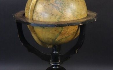 """Globe. According to H.A Willionk in Arnhem, factory of J. Felki in Prague. Engraved brass meridian circle (missing the rotation knob on the axis). Equatorial table resting on a tripod base in blackened wood attached to a compass. Mention : """"..."""