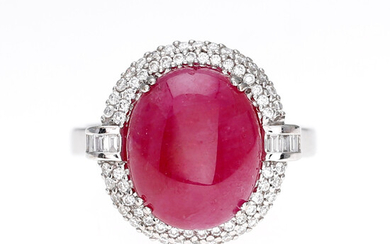 Ring with ruby bordered with diamonds.