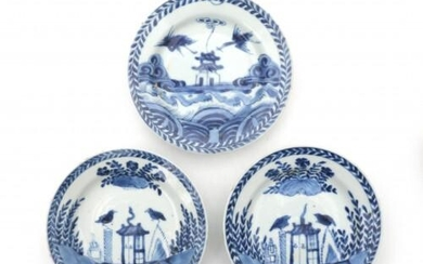 Three Chinese blue and white saucers, with 'cuckoo in house' decoration. Kangxi period (1662-1722)