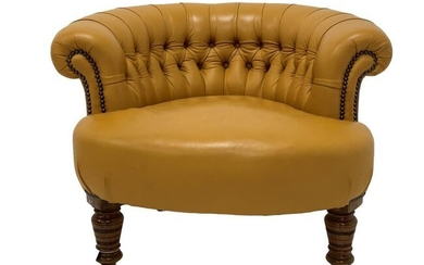 Victorian tub shaped chair upholstered in deep buttoned and...