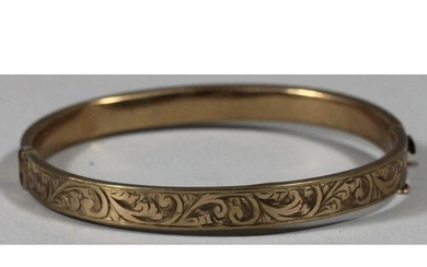 A 9ct gold hollow bangle, with engraved front, 10 gms.