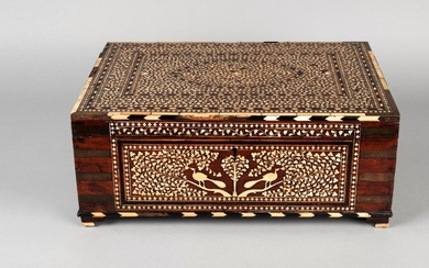 A large Horshiapur ivory inlaid chest, India, 19th century, of rectangular form, with hinged lid, inlaid with design of ovoid medallion to lid with two surrounding rectangular cartouches in ebony and ivory chevrons, on a dense ground of leaves, the...