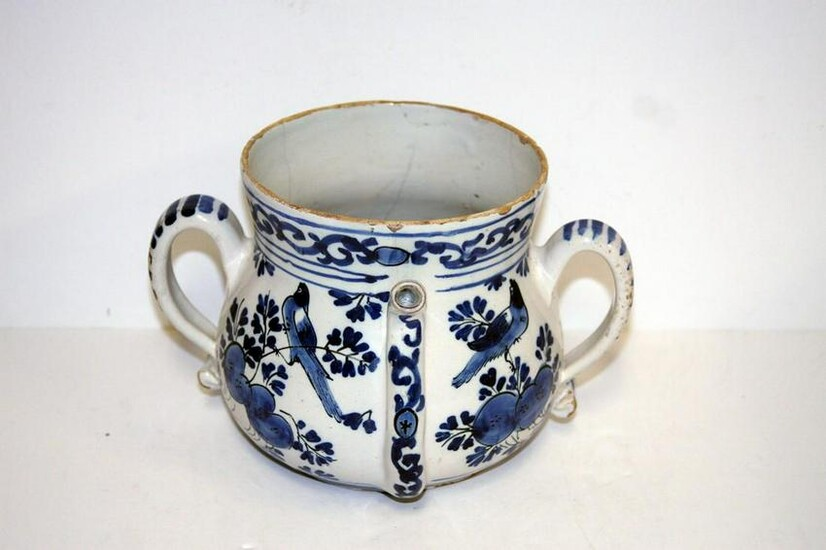A late 17th century London delft posset pot decorated