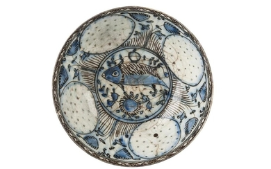 A late Safavid blue and black bowl with fish, Iran, 18th century, on a short foot, the sides with pierced roundels, the centre well with fish, a band of black hatching to rim, 22cm. diam.
