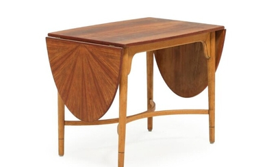 A nut coffee table in convex shaped top, with beech frame. 1960s. H. 61. L. 75/171. W. 53 cm. – Bruun Rasmussen Auctioneers of Fine Art