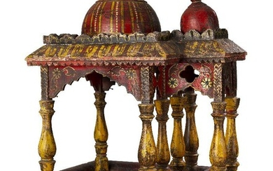 A painted and gilded wooden model of a howdah, India, 19th century, on bracket feet, the rectangular superstructure with chaitya-form archways and surmounted by crenelated band enclosing a tall faceted wood dome, painted in red, yellow and white...