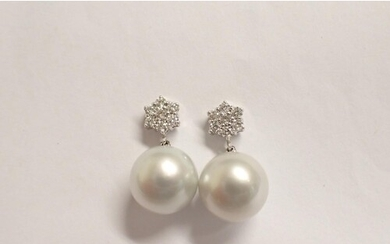 A pair of Diamond and Cultured Pearl Earrings each set clust...