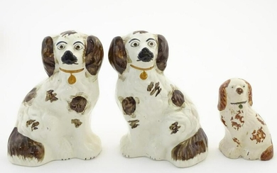 A pair of Staffordshire pottery seated spaniels