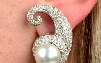 A pair of cultured pearl and pavé-set diamond scroll earrings.