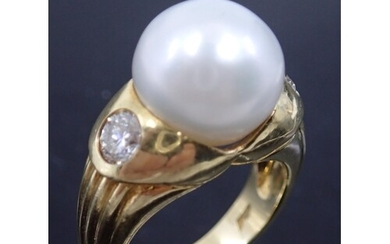 A pearl and diamond set 18kt gold signed ring, finger size M...
