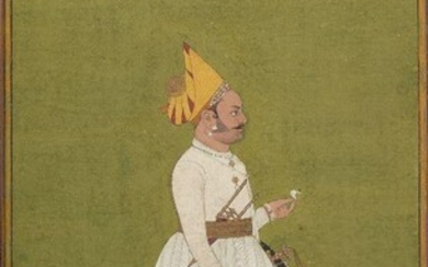 A portrait of a courtier, Bikaner school, India, circa 1800, opaque pigments on paper, shown facing right, wearing white robes and a yellow hat with jewelled band set back from his face, a sword, shield and dagger at his waist, mounted, glazed and...