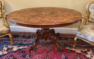 A really good Victorian Walnut Inlaid oval Centre Table with...