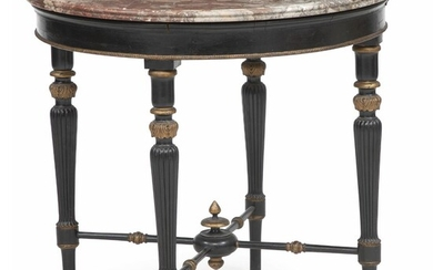 NOT SOLD. A round Empire style ebonized and giltwood occasional table. C. 1920. Marble top presumably France, early 19th century. H. 77 cm. Diam. 82 cm. – Bruun Rasmussen Auctioneers of Fine Art