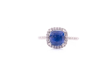 A sapphire and diamond cluster ring; the cushion cut...