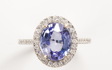 A tanzanite, diamond and eighteen karat white gold ring