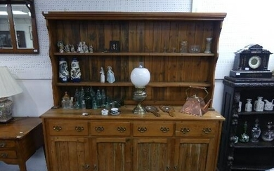 A vintage pine Dresser, the two-tier plate rack set on a bas...